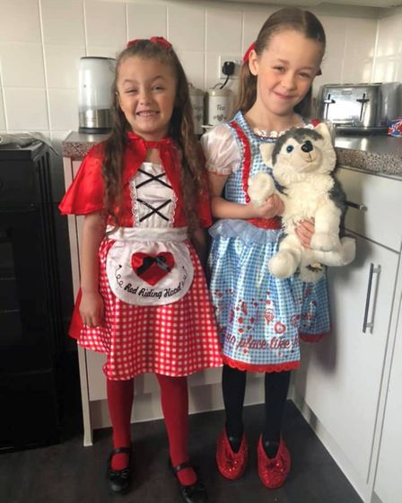 Darcie Bayliss, seven, as Dorothy and Marlie Bayliss, five, as Little Red Riding Hood for World Book