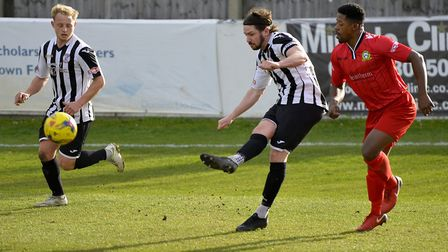 Captain Robbie Parker in action for St Ives Town against Barwell. Picture: DUNCAN LAMONT