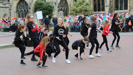Urban Dance Academy perform in front of the yarnbomb on the railings of All Saints' Church, Huntingd