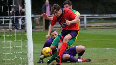 Dan Trendall pounces to put St Neots Town ahead at Hitchin Town. Picture: MARK RIDER