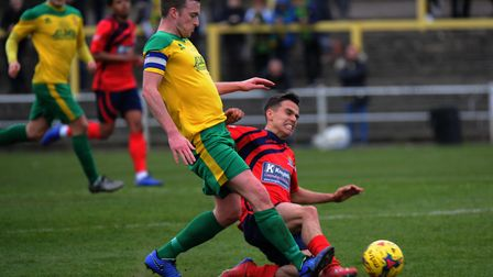 St Neots Town man Joe Sutton makes a challenge during their victory at Hitchin Town. Picture: MARK R