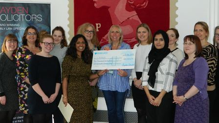 Raydens solicitors hand over cheque to St Albans and Hertsmere women's refuge.