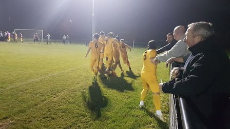 Colney Heath players celebrate Andy Sears-Black's stoppage time winner against Hadley in the 2019 He