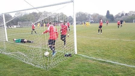 Colney Heath players rush to congratulate Josh Humbert after he opened the scoring against Hadley in