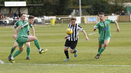 St Ives Town man Ben Seymour-Shove finds himself surrounded during their defeat to Alvechurch. Pictu
