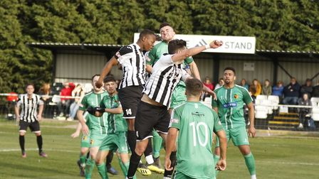 Tom Wood and Munashe Sundire are involved in this aerial challenge during St Ives Town's loss to Alv
