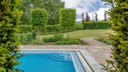 There is a heated outdoor swimming pool, with a pool house. Picture: Strutt & Parker