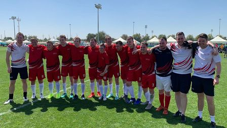 The Great Britain football team celebrate their gold medal at the Special Olympics.