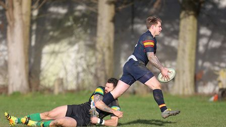 Jack Reilly slips a tackle from Alex Banna in the match between Stevenage Town RFC v Tabard. Picture