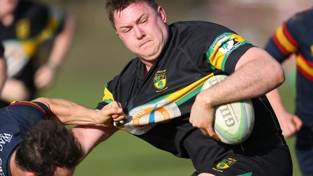 Philip Pearson holds off a tackle in the match between Stevenage Town RFC v Tabard. Picture: DANNY L