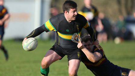 Gareth Lewis looks for a pass in the tackle in the match between Stevenage Town RFC v Tabard. Pictur