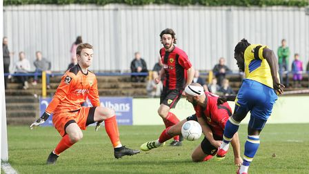 St Albans City's Solomon Sambou sees an early chance saved against Gloucester City.Picture: Kary