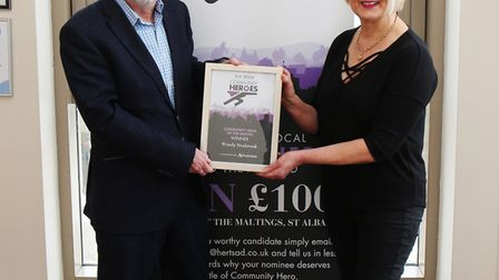 Wendy Seabrook is presented her Maltings Community Heroes award by centre manager Phil Corrigan. Pic