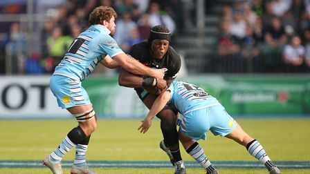 Maro Itoje of Saracens takes a hit in the Heineken Champions Cup game between Saracens v Glasgow War