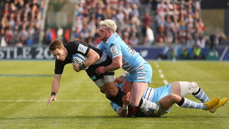 Liam Williams of Saracens goes down in a tackle in the Heineken Champions Cup game between Saracens