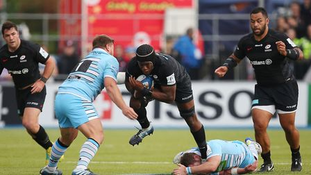 Maro Itoje of Saracens carries the ball in the Heineken Champions Cup game between Saracens v Glasgo