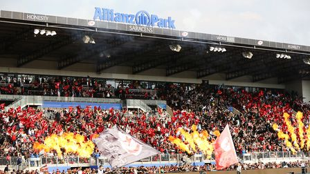 Fans welcome the teams in the Heineken Champions Cup game between Saracens v Glasgow Warriors at the