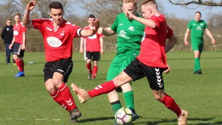 Matt Gee forces his way past two Phoenix defenders to score Blacksmiths' opening goal. Picture: BRIA