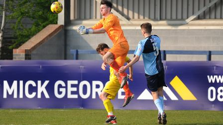 St Neots goalkeeper James Philp packs a punch in their clash with Banbury. Picture: MARK RIDER