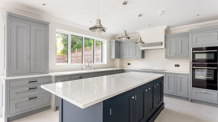 The kitchen is fitted with beautifully handcrafted bespoke units with quartz worktops and features a
