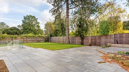 To the rear is a professionaly landscaped south facing garden, which is principally laid to lawn wit