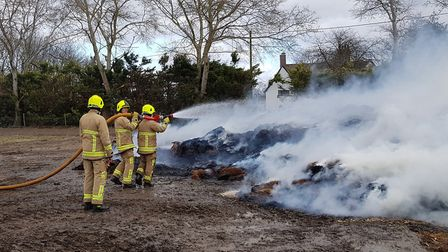 Crews tackle a 100-tonne straw blaze in Ashwell. Picture: Herts Fire