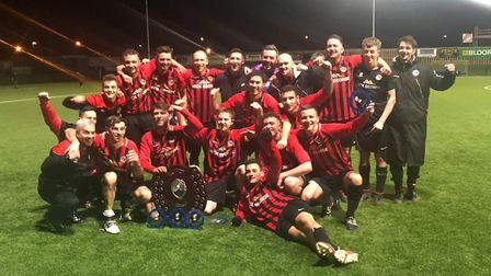 Houghton & Wyton celebrate their Creake Charity Shield triumph. Picture: SUBMITTED