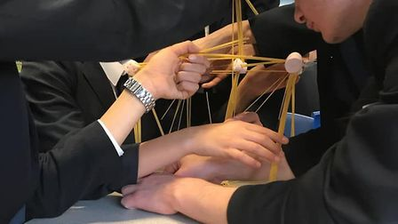 Verulam School pupils doing the Metrobanks activity where they built structures with spaghetti and m