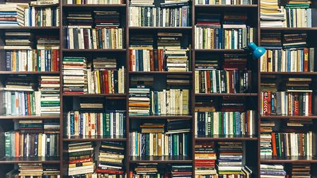 Crammed bookshelves and displays of coffee-table books are Aries' trademark. Picture: Getty