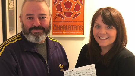 Jon Prayer presenting the cheque to Cassie Leaver following the St Albans Pioneer Club indie night.