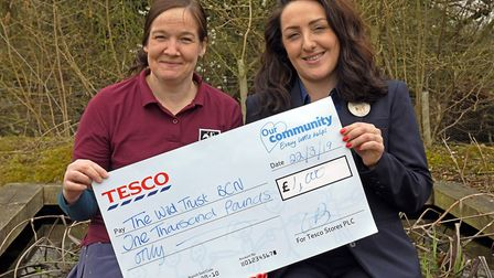 Debbie McKenzie from the Bedfordshire and Cambridgeshire Wildlife Trust receives a cheque for 1,000