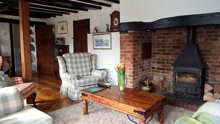 The sitting room features a most impressive Inglenook fireplace with wood burning stove. Picture: Pu