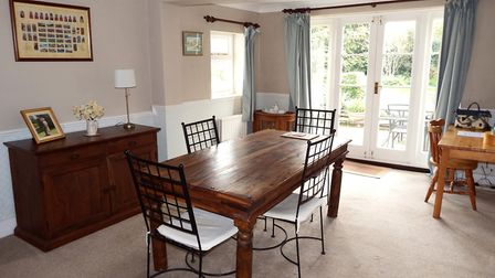 Doors from the dining room lead out to the garden. Picture: Putterills