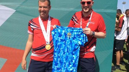 Left to right: Tom Ward and Liam Dwyer, with a St Albans t-shirt. St Albans and Harpenden athletes c