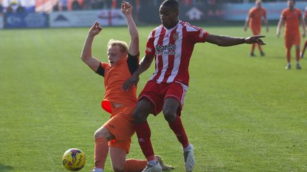 Ollie Snaith makes a tackle during St Ives Town's draw at Stourbridge. Picture: LOUISE THOMPSON