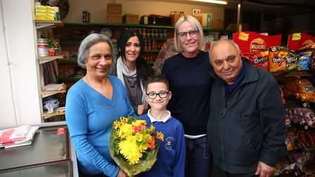 Jay (left) and Kumar Balani (right), with staff Claire (second from right) and loyal customers, are