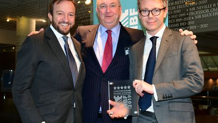 Home Builders Federation's Stewart Baseley presents the five-star award to Clinton McCarthy and Simo