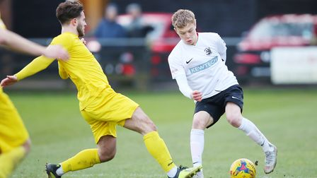 Joe Newton turns inside his man in the match between Royston Town v Banbury United. Picture: DANNY L