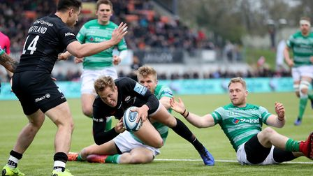 Saracens' Max Malins scores a try during the Gallagher Premiership match with Newcastle Falcons at A