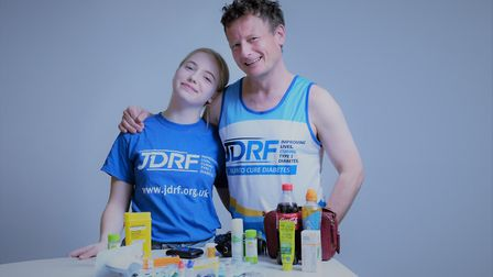 St Albans' Jason Wills with his daughter Maddie. He is running the London Marathon for JDRF. Picture