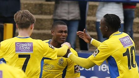 Ben Wyatt and David Moyo are the first to congratulate Khale Da Costa on his perfectly-taken goal. P