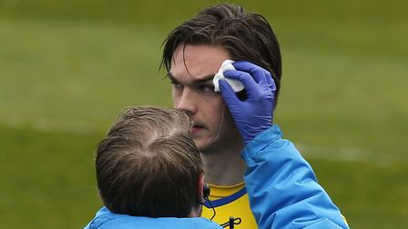 Tom Bender receives running repairs after a clash of heads with team-mate Ben Wyatt. Picture: LEIGH