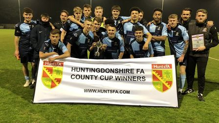 St Neots Town toast their triumph in the Hunts Under 18 Cup. Picture: HUNTS FA