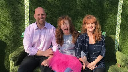 Lucy Conrad with dad Chris and mum Debbie in their garden