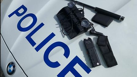 Officers seized a Taser, an extendable baton, a police warrant card holder and after a further searc