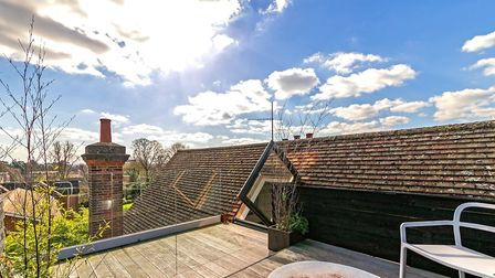 The property has its own roof terrace complete with decking area and glass dividers. Picture: Cassid