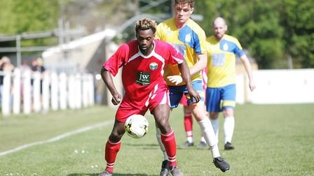 Harpenden Town V London Colney - Issac Olaleye in action for London Colney shields the ball from Jak