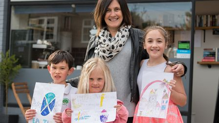 Archie Makepeace, 8, Emily Secker 5, Emily Gardner, 10, with Bean Central owner Donna Gray. Picture: