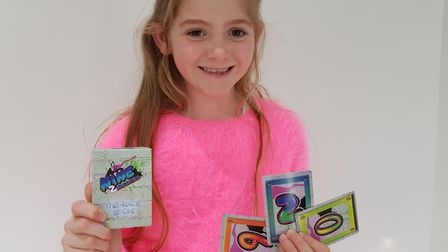 Summer Phillips with the card game she invented.