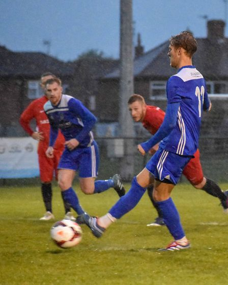Jack Chandler launches the Godmanchester Rovers comeback from the penalty spot. Picture: JAMES RICHA